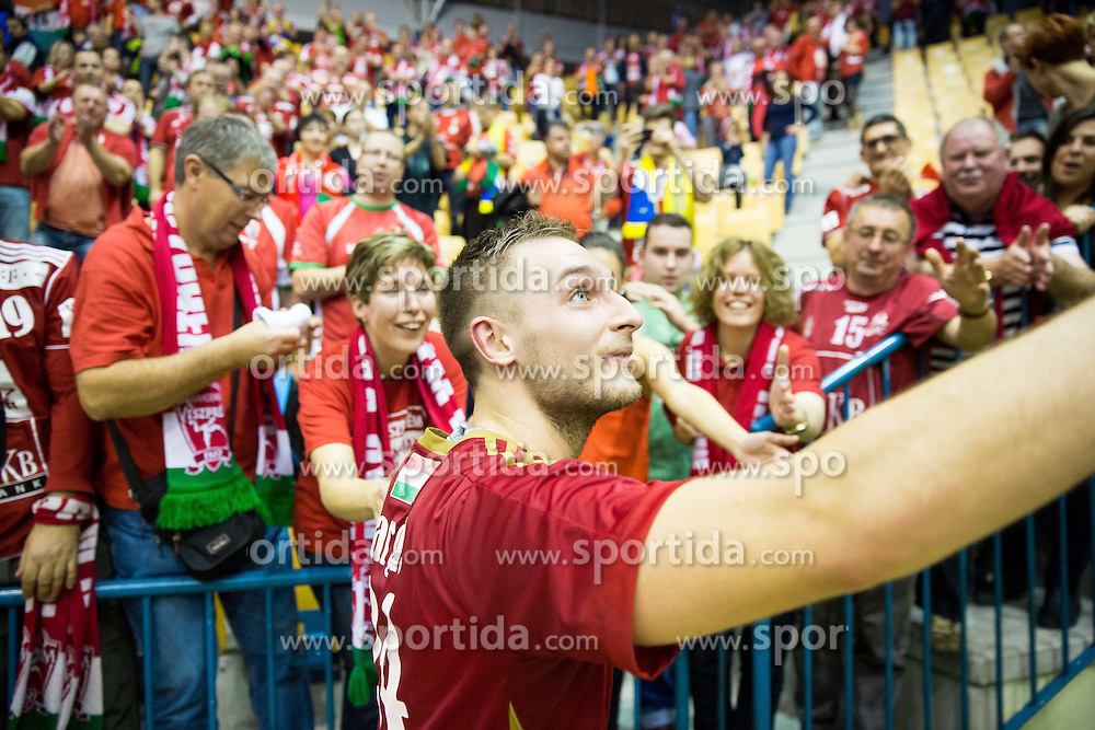 Gasper Marguc of Veszprem with supporters of Veszprem after the handball match between RK Celje Pivovarna Lasko (SLO) and MVM Vesprem (HUN) in Round #7 of EHF Champions League 2015/16, on November 15, 2015 in Arena Zlatorog, Celje, Slovenia. Photo by Vid Ponikvar / Sportida