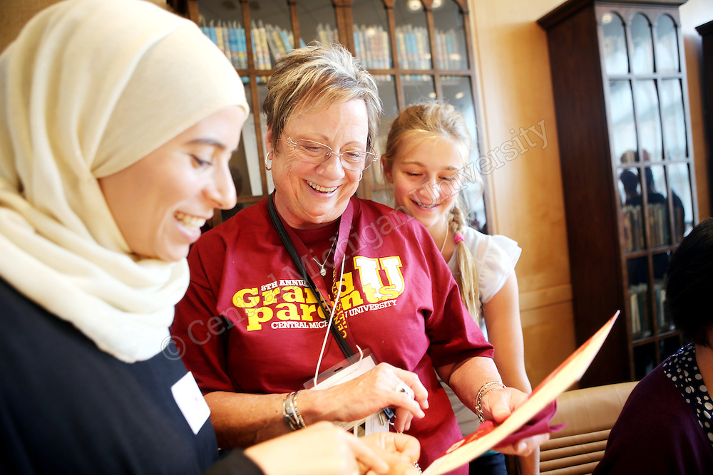 Graduate Student Duha Hamed writes names in Arabic for the Grandparents U participants photo by Emily Mesner