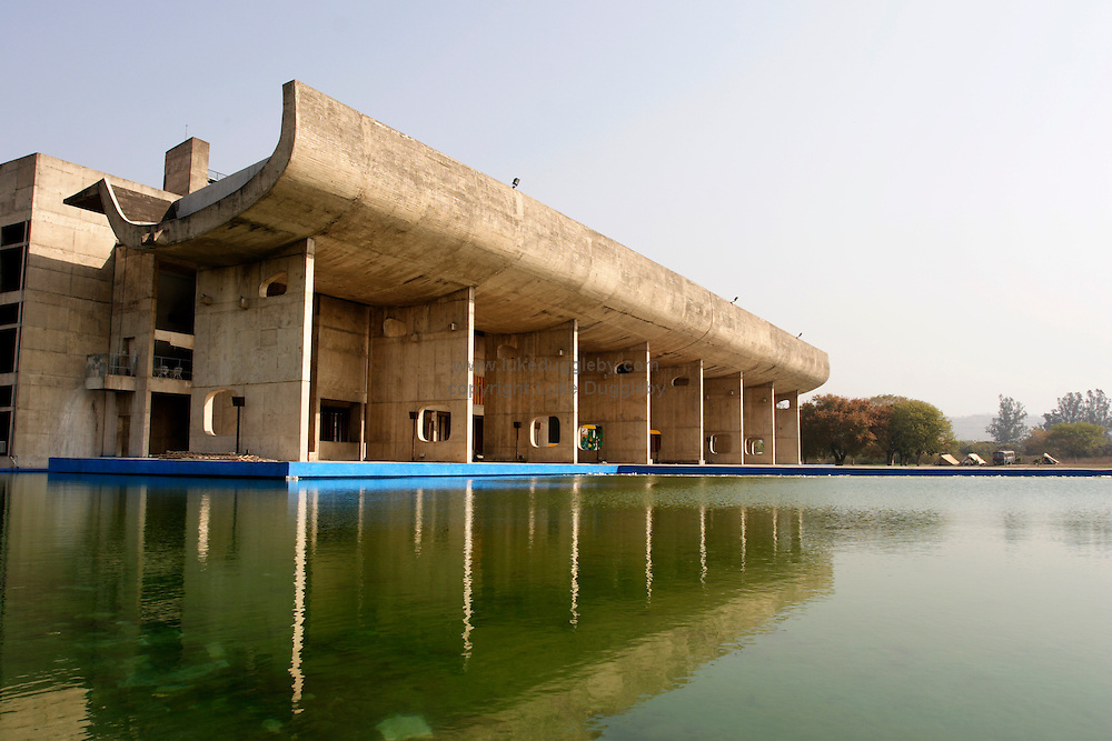 15 March 2008 - Chandigarh, India - The National Assembly complex building in the Capitol complex, all designed by Le Corbusier. The Swiss-French architect Le Corbusier was commissioned by India's first Prime Minister Jawaharlal Nehru in 1952 to create a brand new capital from scratch. Due to strict building codes and zoning laws Chandigarh has grown within a planned structure unlike any other city in India. The result is India's most unchaotic city covered with modernist buildings, whether Government centres or public housing, a quarter of which is dedicated to open spaces and parks all designed by the visionary architect. It is also India's first city where smoking in public is illegal. Photo Credit: Luke Duggleby
