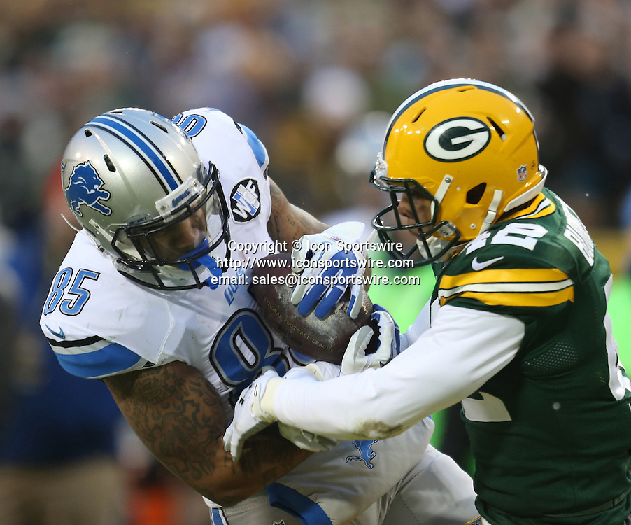 Dec. 28, 2014 - Green Bay, WI, USA - Detroit Lions' Eric Ebron has the ball stripped away by the Green Bay Packers' Morgan Burnett during first half action Sunday, Dec. 28, 2014 at Lambeau Field in Green Bay, Wis. The Packers won 30-20