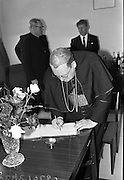 10/07/1967<br /> 07/19/1967<br /> 19 July 1967<br /> Cardinal John Cody of Chicago with American pilgrims in Drogheda. Cardinal Cody led 350 pilgrims to the shrine of Blessed Oliver Plunkett in Drogheda. There in the Cathedral he and His Eminence Cardinal William Conway Archbishop of Armagh and Primate of All Ireland consecrated Mass. After mass the Cardinals and pilgrims went to the Medical Missionaries of Mary Hospital for lunch. Image shows Cardinal Cody signing a visitors book, probably at the Medical Missionaries of Mary Hospital, Drogheda.