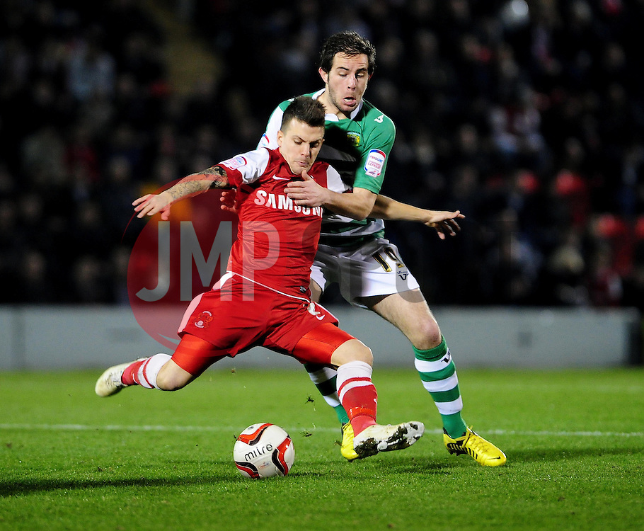 Yeovil Town Kevin Dawson adds pressure to Leyton Orient's Dean Cox - Photo mandatory by-line: Dougie Allward/JMP - Tel: Mobile: 07966 386802 09/01/2013 - SPORT - FOOTBALL - Matchroom Stadium - London -  Leyton Orient v Yeovil Town - Johnstone's Paint Trophy Southern area semi-final.