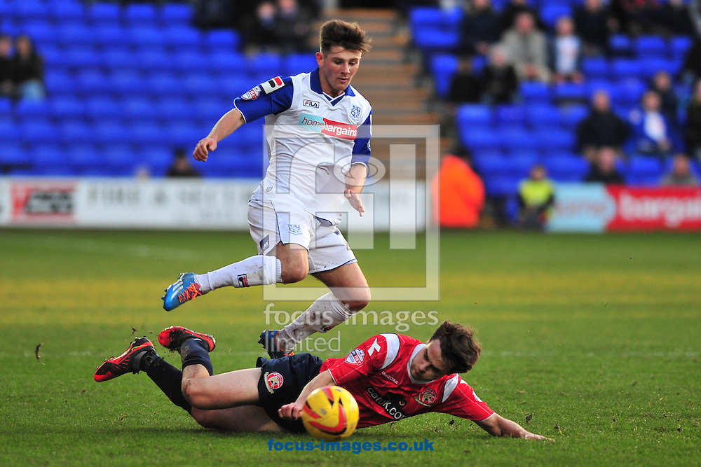 Picture by Ste Jones/Focus Images Ltd +44 7706 592282<br /> 11/01/2014<br /> Andy Taylor of Walsall slides in on Matthew Kennedy of Tranmere Rovers during the Sky Bet League 1 match at Prenton Park, Birkenhead.