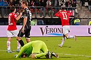 ALKMAAR - 26-09-2015, AZ - Heracles Almelo, AFAS Stadion, 3-1, AZ speler Muamer Tankovic (r) trekt zijn shirt uit na de 3-1 die hij scoorde, Heracles Almelo keeper Bram Castro, teleurstelling.