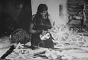 A Hopi woman in Shungopavi, Arizona, weaving a plaited-style basket, photograph by Adam Clark Vroman, 1901, courtesy of the Colorado Historical Society, from the William Henry Jackson Collection, in the Anasazi Heritage Center, an archaeological museum of Native American pueblo and hunter-gatherer cultures, Dolores, Colorado, USA. Picture by Manuel Cohen