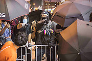 HONG KONG: 07 October 2019 Protesters shout as they construct barricades during clashes with riot police in the Mong Kok region of Hong Kong this evening. Violence has continued throughout the city despite the introduction of a new law stating no masks can be warn which, in turn, has escalated the anger of the protesters.   <br /> Rick Findler / Story Picture Agency