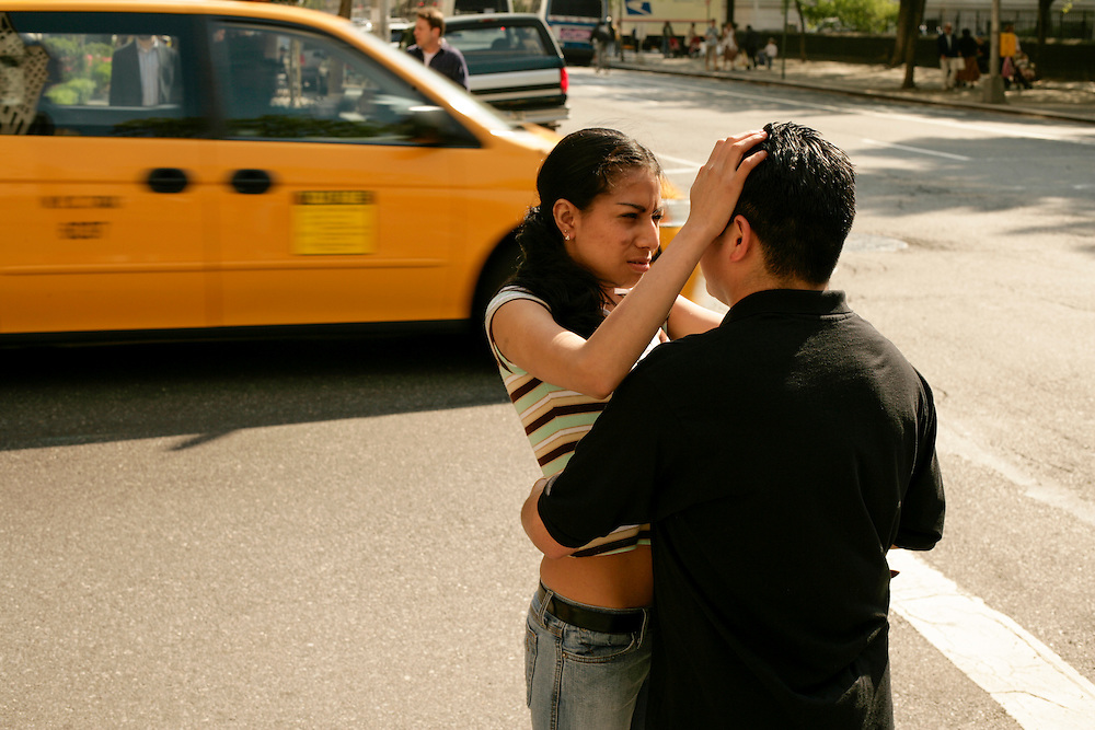 A couple embracing near Central Park in New York.