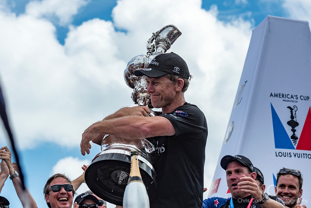 The Great Sound, Bermuda, 26th June 2017. Emirates Team New Zealand shore crew manager Sean Regan with the America's Cup.