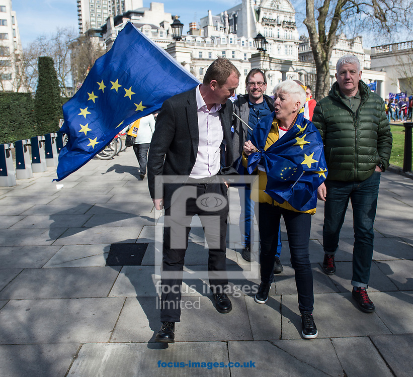 Tim Farron, leader  of the Liberal Democrats, has announced he is standing down in the wake of the General Election.  Westminster, London<br /> Picture by Daniel Hambury/Stella Pictures Ltd 07813022858<br /> 14/06/2017<br /> <br /> SPL TIM FARRON MP 08.jpg<br /> <br /> Original Caption:<br /> Tim Farron MP speaks to a member of the public at Unite for Europe march, starting in Park Lane and ending in a rally in Parliament Square.<br /> Picture by Daniel Hambury/Stella Pictures Ltd 07813022858<br /> 25/03/2017