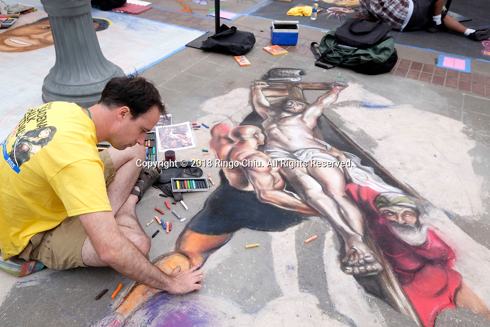Artists work on their pieces during the 26th annual Pasadena Chalk Festival in Pasadena, California, on June 18, 2018. (Photo by Ringo Chiu)<br /> <br /> Usage Notes: This content is intended for editorial use only. For other uses, additional clearances may be required.