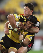 Chiefs first five Callum Bruce tackles Victor Vito.<br /> Super 14 rugby match - Hurricanes v Chiefs at Westpac Stadium, Wellington. Saturday, 1 May 2010. Photo: Dave Lintott/PHOTOSPORT