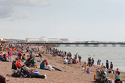 © under license to London News Pictures. 21/07/12. As temperatures rise this weekend, people enjoy a rare break in the wet weather on Brighton beach. Xavier Itter/LNP