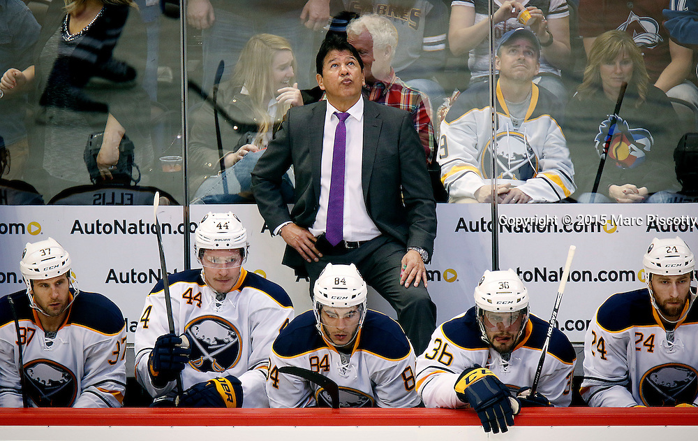 SHOT 3/28/15 8:14:17 PM - The Buffalo Sabres head coach Ted Nolan watches a replay during their regular season NHL game against the Colorado Avalanche at the Pepsi Center in Denver, Co. The Avalanche won the game 5-3. (Photo by Marc Piscotty / © 2015)