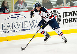 March 12 2016: Robert Morris Colonials forward Brandon Denham (44) skates the puck up ice during the third period in game two of the Atlantic Hockey quarterfinals series between the Bentley Falcons and the Robert Morris Colonials at the 84 Lumber Arena in Neville Island, Pennsylvania (Photo by Justin Berl)