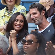 2019 US Open Tennis Tournament- Day Thirteen.    Meghan Markle, Duchess of Sussex next to Patrick Mouratoglou, coach  of Serena Williams in the the team box watching Serena Williams of the United States in action against Bianca Andreescu of Canada in the Women's Singles Final on Arthur Ashe Stadium during the 2019 US Open Tennis Tournament at the USTA Billie Jean King National Tennis Center on September 7th, 2019 in Flushing, Queens, New York City.  (Photo by Tim Clayton/Corbis via Getty Images)