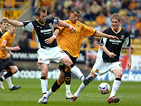 Photo: Ed Godden/Sportsbeat Images.<br />Wolverhampton Wanderers v Hull City. Coca Cola Championship. 09/04/2007. Hull's Ian Ashbee (L), is kept off the ball.