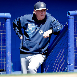 Mar 14, 2013; Dunedin, FL, USA; New York Yankees pitching coach Larry Rothschild (58)  looks on from the dugout during the bottom of the second inning of a spring training game against the Toronto Blue Jays at Florida Auto Exchange Park. Mandatory Credit: Derick E. Hingle-USA TODAY Sports
