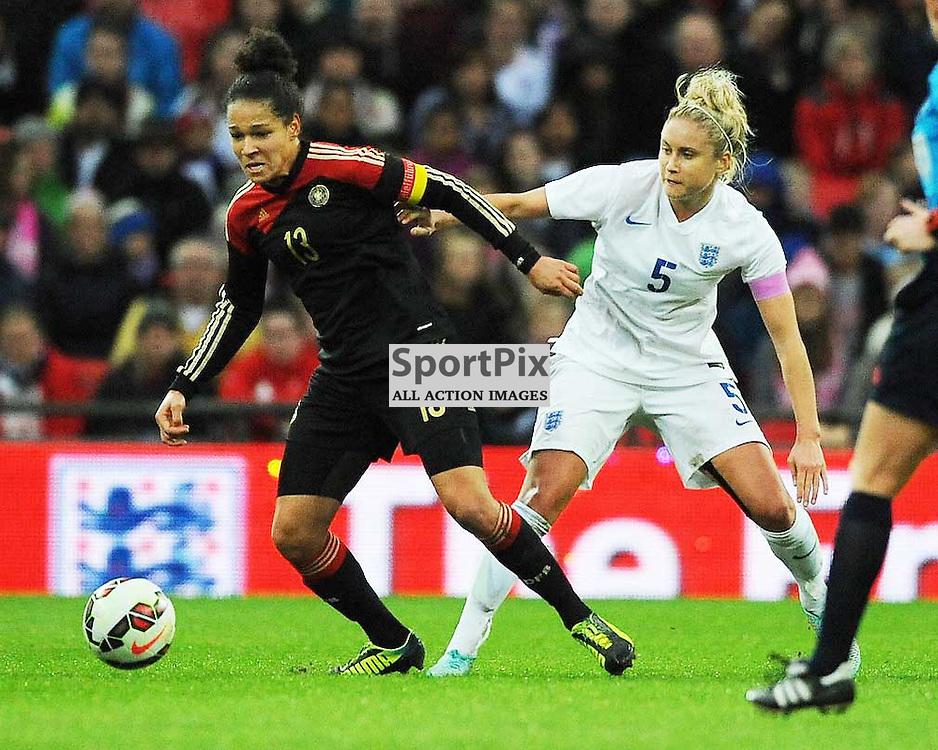England's Steph Houghton, marks Germanys Celia Sasic, England v Germany Ladies, Breast Cancer Care International, Wembley , Sunday 23rd November 2014