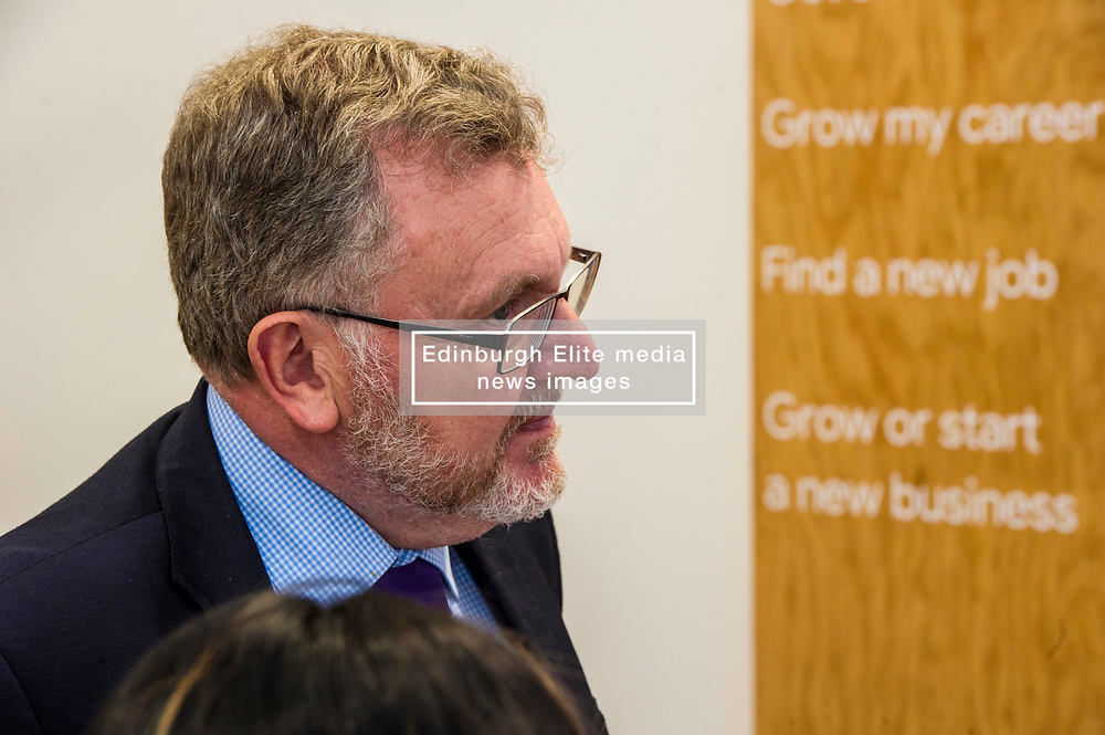 Pictured: David Mundell eyed the menu at the entrance and one entry appeared to catch his eye<br /> <br /> Scottish Secretary David Mundell visited a 'digital garage' in Edinburgh which trains people in digital skills. The Google Digital Garage, in Shandwick Place is a social responsibility outlet for the corporate giant<br /> <br /> <br /> Ger Harley | EEm 23 July 2018