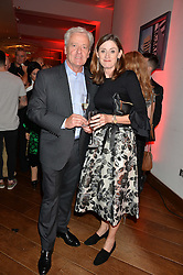 AMANDA BERRY Chief Executive of BAFTA and her husband PHILIP at a party to celebrate the 21st anniversary of The Roar Group hosted by Jonathan Shalit held at Avenue, 9 St.James's Street, London on 21st September 2015.