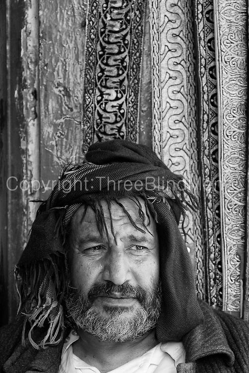 Yemen. <br />Portrait of gentleman in the Souk.