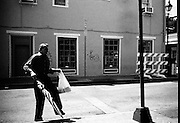 A man strolls down a street in the French Quarter in New Orleans.