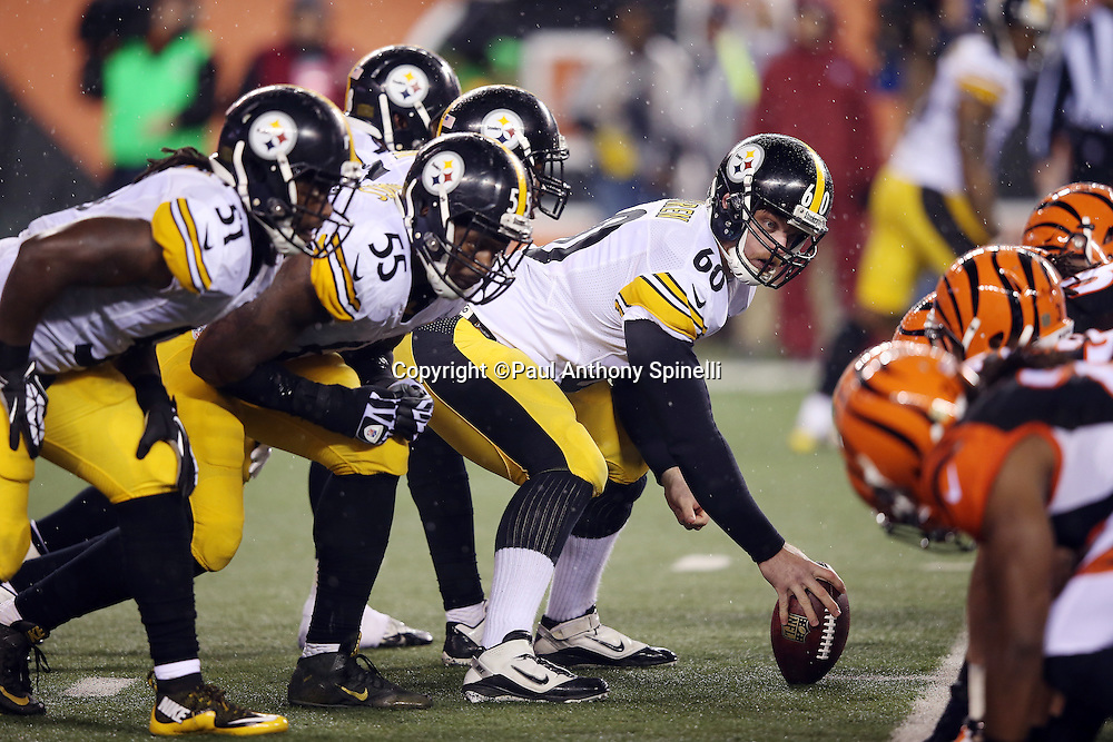 Pittsburgh Steelers long snapper Greg Warren (60) looks at the defensive alignment as the Steelers offensive line gets set for the snap opposite the Cincinnati Bengals defensive line at the line of scrimmage during the NFL AFC Wild Card playoff football game against the Cincinnati Bengals on Saturday, Jan. 9, 2016 in Cincinnati. The Steelers won the game 18-16. (©Paul Anthony Spinelli)