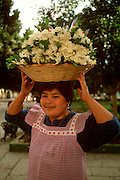 MEXICO, COLONIAL CITIES Oaxaca, Zocalo with a flower vendor