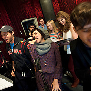 """December 5, 2013 - New York, NY: The cast of the NBC musical drama television series """"Smash"""" including, at microphones in foreground from left, Jeremy Jordan, Krysta Rodriguez, and Andy Mientus, rehearse at Smash Studios at 36th Street in Manhattan on Thursday afternoon in preparation for their cabaret performance of """"HIT LIST,"""" which will premiere Sun, Dec 8 at 54 Below.  Also pictured, in background from left, are Benjamin Rauhala (piano), Molly Hager (vocals), Eric Michael Krop (vocals), Julia Mattison (vocals), Monet Julia Sabel (vocals), and Shannon Ford (drums). CREDIT: Karsten Moran for The New York Times"""