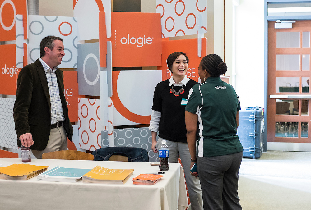 Representatives from Ologie share a laugh with UCM's Renea Morris during the CCN Expo in Walter Hall Rotunda on Wednesday, May 13, 2015.  Photo by Ohio University  /  Rob Hardin