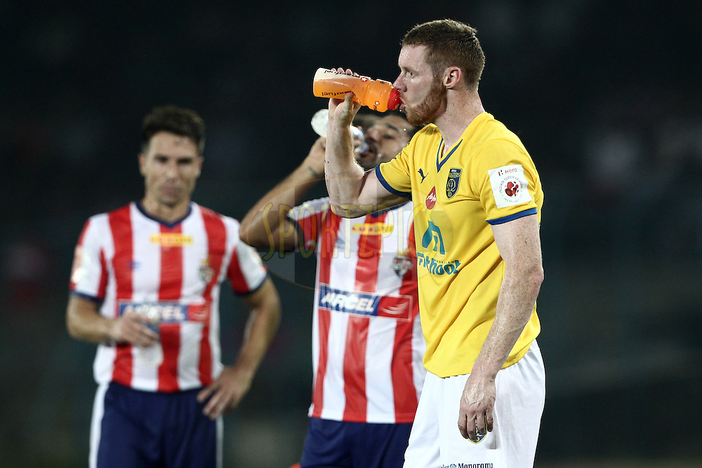 Stephen Pearson of Kerala Blasters FC drinking during match 13 of the Hero Indian Super League between Atl&eacute;tico de Kolkata and Kerala Blasters FC held at the Salt Lake Stadium in Kolkata, West Bengal, India on the 26th October 2014.<br /> <br /> Photo by:  Deepak Malik/ ISL/ SPORTZPICS