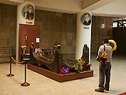 A campesino pays his respects at the tomb of Archbishop Oscar Romero of El Salvador at San Salvador's Metropolitan Cathedral. The Archbishop was slain at the alter of his Church of the Divine Providence by a right wing gunman in 1980. Óscar Arnulfo Romero y Galdámez was a bishop of the Catholic Church in El Salvador. He became the fourth Archbishop of San Salvador, succeeding Luis Chávez, and spoke out against poverty, social injustice, assassinations and torture. Romero was assassinated while offering Mass on March 24,1980.- To license this image, click on the shopping cart below -