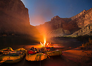 Relaxing by a camp fire under a starry sky after a long day rafting the Colorado River in the Grand Canyon.