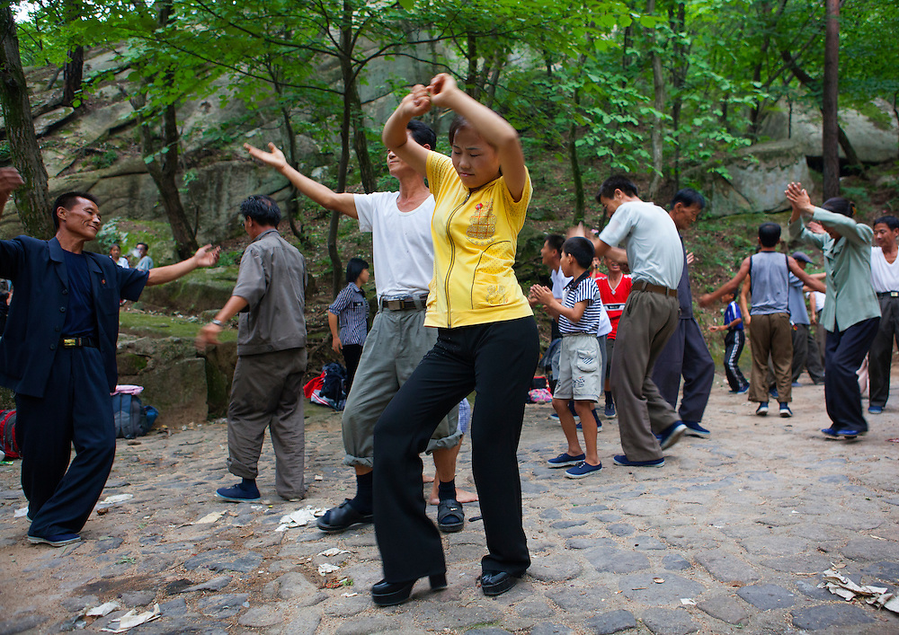 -Do you know Michael Jackson?<br /> -I have heard of him, yes.<br /> -And Lady Gaga?<br /> -I don't know who he is, no...<br /> <br /> Electricity company workers dancing in a park, Kaesong waterfall, North Korea.