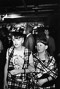 Two young Adam & The Ants fans, at a gig, wearing matching tartan outits, London, UK, 1980's.
