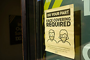 01 AUGUST 2020 - DES MOINES, IOWA: A sign asking people to wear masks on the front door of a grocery store in Des Moines. About 50 doctors, medical professionals, and public health professionals from across Iowa came to the State Capitol to demand that Iowa Governor Kim Reynolds impose a mask mandate to control the spread of the coronavirus (SARS-CoV-2). Despite the continued spread of the coronavirus and rapidly increasing infection rate for COVID-19, the Governor has refused to impose a mask mandate or close businesses. For the week ending Saturday, Aug. 1, Iowa reported new 2,736 new cases of COVID-19.              PHOTO BY JACK KURTZ
