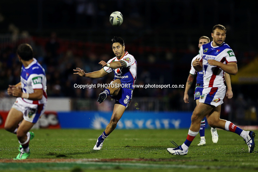 Warriors' Shaun Johnson chips the ball ahead. Round 12 NRL Telstra Premiership game, Vodafone Warriors v Newcastle Knights, Mt Smart Stadium, Auckland, New Zealand. Sunday 1st June 2014. Photo: photosport.co.nz