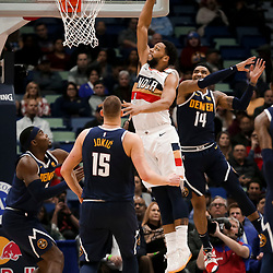 Jan 30, 2019; New Orleans, LA, USA; New Orleans Pelicans center Jahlil Okafor (8) dunks over Denver Nuggets guard Gary Harris (14) and center Nikola Jokic (15) during the second quarter at the Smoothie King Center. Mandatory Credit: Derick E. Hingle-USA TODAY Sports