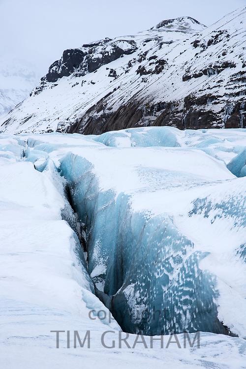 Close up showing dangerous deep crevasse fracture on Svinafellsjokull glacier an outlet glacier of Vatnajokull, South Iceland