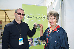 LIVERPOOL, ENGLAND - Sunday, June 19, 2011: Virginia Wade with a sponsor during day four of the Liverpool International Tennis Tournament at Calderstones Park. (Pic by David Rawcliffe/Propaganda)