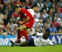 Photo Aidan Ellis.<br />Liverpool v Tottenham Hotspur.<br />FA Barclaycard Premiership.<br />27/08/2003.<br />Liverpool's Milan Baros and Spurs Anthony Gardener and Mauricio Taricco