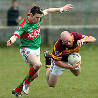 Miltown's 13 takes a tumble under the pressure of Kilmurry Ibrickane's Stephan Hickey during their game in Miltown Malbay on Sunday.<br /> Photograph by Yvonne Vaughan