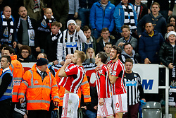 Yoan Gouffran of Newcastle United (centre) celebrates with Sebastian Larsson and Will Buckley in front of the newcastle fans after scoring a goal to make it 0-1 - Photo mandatory by-line: Rogan Thomson/JMP - 07966 386802 - 21/12/2014 - SPORT - FOOTBALL - Newcastle upon Tyne, England - St James' Park - Newcastle United v Sunderland - Tyne-Wear derby - Barclays Premier League.