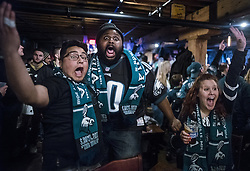 February 4, 2018 - Minneapolis, MN, USA - At Blarney Pub and Grill, Eagles fans John Henry, Jarrell Cunningham, and Kalie Havener cheer for their team as it progresses up the field Sunday, Feb. 4, 2018 in Minneapolis, Minn. Henry and Cunningham drove from Philly to visit their friend Havener. The bar was a designated Eagles fans drinking hole for many who came from out of town including Philly. (Credit Image: © Richard Tsong-Taatarii/TNS via ZUMA Wire)