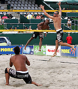 Charles Leota (NZ) spikes the ball during the NZ Beach Volleyball Open at Stanley St, Auckland, 20 January 2006. Photo: Tim Hales/PHOTOSPORT<br />