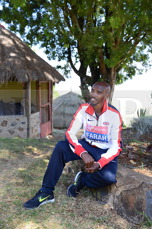 © London News Pictures. 30/01/2013. Iten, Kenya. VIRGIN MONEY LONDON MARATHON 2014 PREVIEW... Mo Farah, GB poses for a photograph after being asked questions by  members of the press about his upcoming marathon debut. The backdrop is The Kerio Valley, which forms part of The Rift Valley. Photo credit: Mike King/London Marathon/LNP