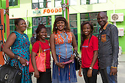 Chika Chukwu with two of her staff and Peace (left) and Ifeoma (right) from Youth for Technology. <br /> <br /> They are outside a local petrol station that bought paint from her. The manager saw the colours in her office and copied the look on his petrol station.<br /> <br /> Chika set up and runs Decency Paints, which sells paint.<br /> <br /> Chika set up her business just over a year ago. The biggest thing that she has learnt from the Youth for Technology training is about managing and investing money. She used to think you needed lots of money to grow the business but now understand you can invest small amounts too.
