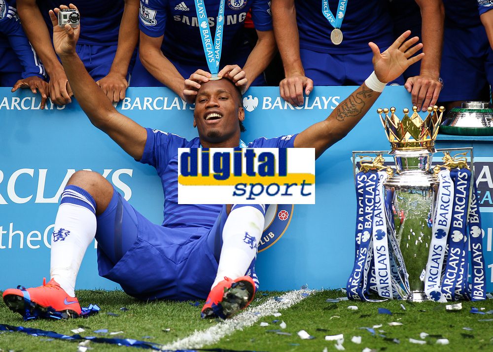 Football - 2014 / 2015 Premier League - Chelsea vs. Sunderland.   <br /> <br /> Chelsea's Didier Drogba with the trophy and a winners medal on his head at Stamford Bridge. <br /> <br /> COLORSPORT/DANIEL BEARHAM