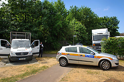 © Licensed to London News Pictures. 24/07/2013 London, UK. General view outside a sports field in Mill Hill East, where forensic team are investigating the murder of a young Hungarian national who's body was found in a suitcase on Sunday (July 21st). A 29 year old has been arrested on suspicion of murdering the young woman found dead in Thornfield Avenue, North West London.<br /> Photo credit : Simon Jacobs/LNP