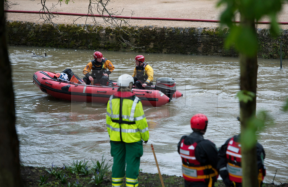 © London News Pictures. 01/05/2012. Oxford, UK. Ambulance crew and dive teams on the River Cherwell in Oxford on April 1, 2012. The river was at unusually high levels during May Day celebrations, when students traditionally attempt to jump in to the river, however this year they where prevented from doing so.  Photo credit : LNP